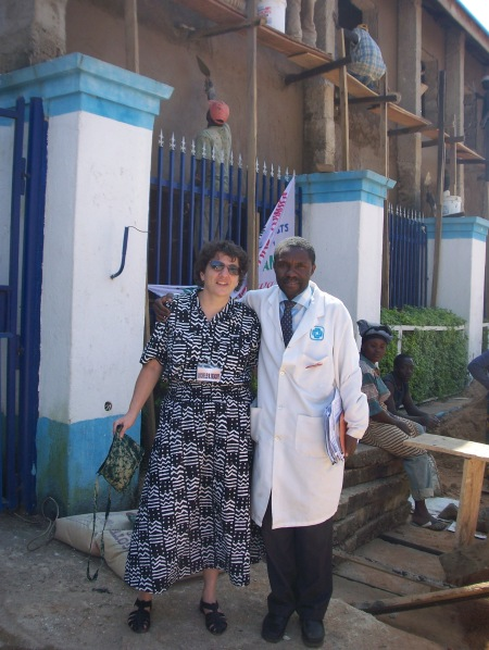 Rochele and Dr Chris Isichei in front of Faith Alive Hospital (new TB center)