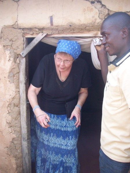 Lois visiting a village home